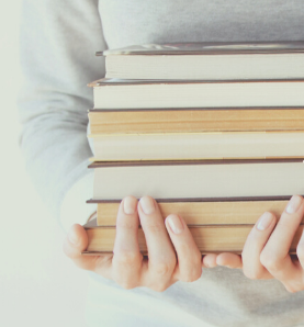 Hands holding books